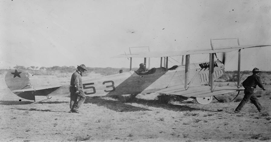 Lt. Carleton Chapman prepares for a recon flight in Mexico in one of the squadron's Curtiss JN-3s. (Library of Congress)