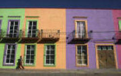 Bright paint decorates a building in Palomas, Mexico, just across the border from Columbus, N.M. Inside is the Pancho Villa Restaurant and souvenir shop that used to draw visitors from the U.S. Now the tourism industry has collapsed over fear about the drug violence in Mexico.